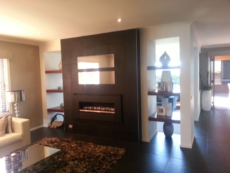 Fireplace with open shelves between rooms.