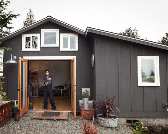 Eclectic Exterior Design -- I really think the grey paint contrasted with the optical white trim is outstanding.  I also like the choice of natural wood doors and the minimal landscape -- it just goes with the entire concept.
