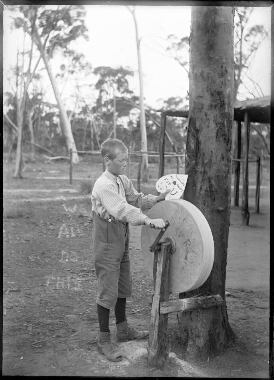"""154254PD: Jack Riches grinding a heart shape with words """"I'm wearing my heart away for U"""", at the Riches family farm, Wyalkatchem, 1907. https://encore.slwa.wa.gov.au/iii/encore/record/C__Rb5127675"""