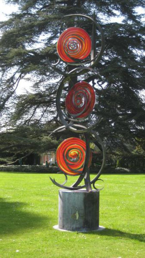 Forged steel and blown stained glass Garden Or Yard / Outside and Outdoor sculpture by artist Jenny Pickford titled: 'Circles of Life (Steel and Blown Coloured Glass garden/Yard sculpture)'
