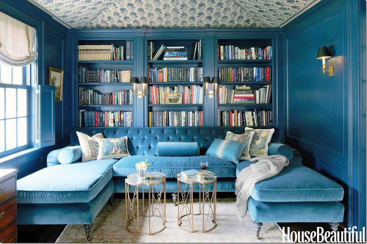 The library is painted in Farrow Ball's Hague Blue.  The silk velvet is matched to the wall   color.  The ceiling is done in Michael Smith Jaspar fabric – which I LOVE