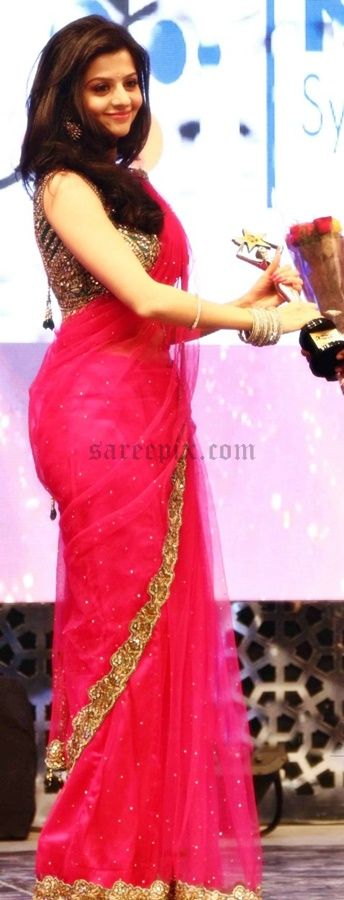 Vedika in saree, spotted at 8th annual edison awards 2015. The curvy actress looked so glamorous in a red netted saree with sleeveless blouse. Free hair st