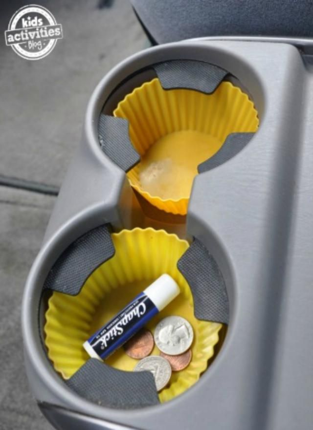 15 Genius Road Trip Hacks Seen on Pinterest | Use cupcake liners to keep car cup holders clean and gunkfree