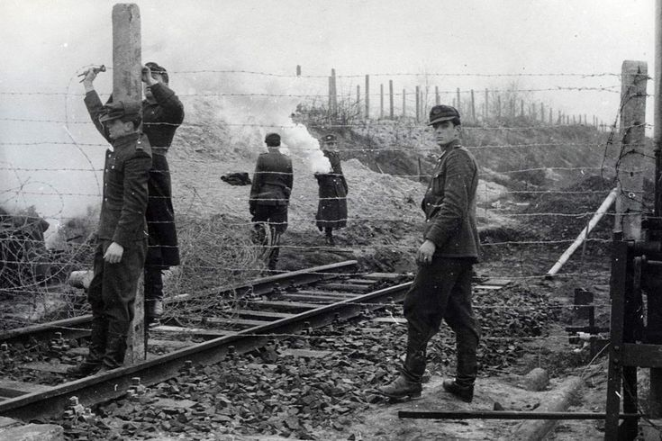 December 1961: East German police tear up train tracks leading to West Berlin after 25 people escaped across the border.