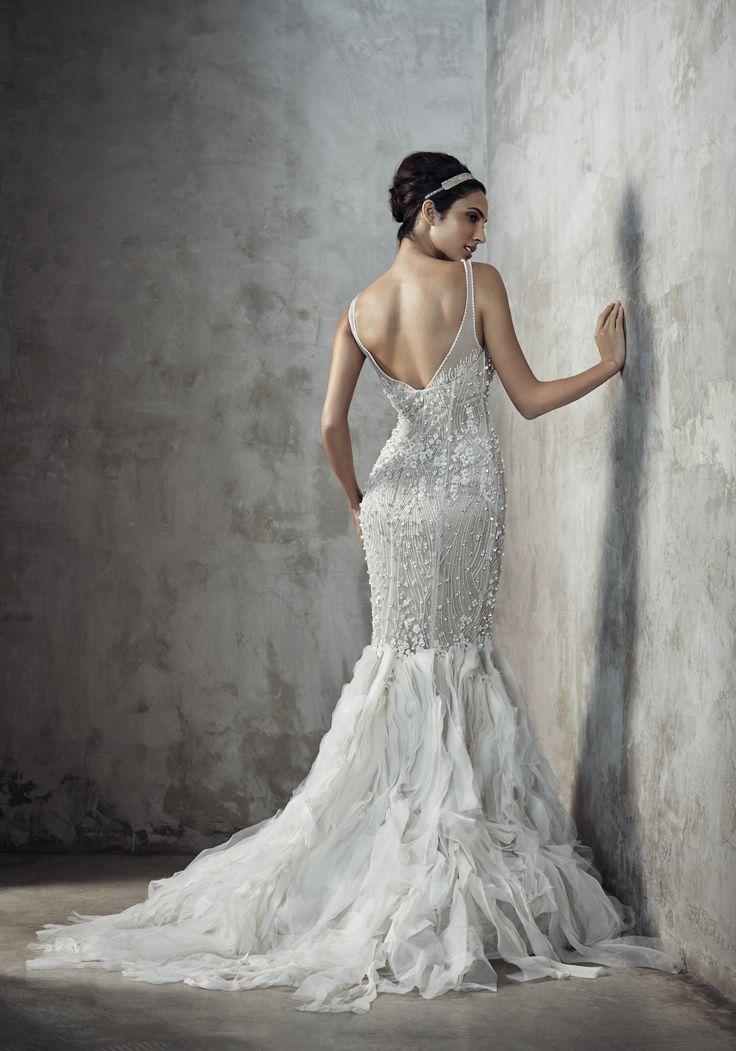 Photographer: Gerald Goh from Imagerom Studio Code: MLC-B14-20066 Description: Fully beaded mermaid gown with mix fabrics strips hemline #weddings #melindalooi #melindalooiivory #ivory #bridal #weddingdress #bridaldress #weddinggown #gown #bridalgown #bride #vintage #embellishments #crystallized #swarovski #glassbeads #waterpearls #beading #beaded #tulle #frenchlace #lace #satin #silk #mermaid