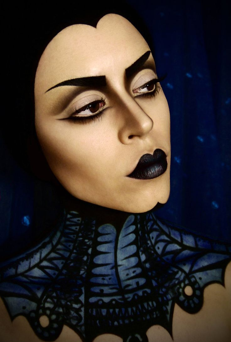 Evil Queen Makeup by ~Mandibulo on deviantART. seems like shadow starts above the crease, instead of along it. The undershadow is cool too.