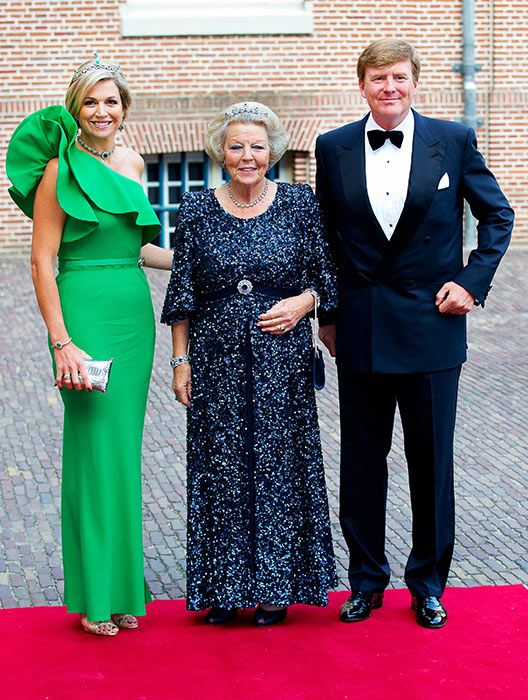 The Dutch royal couple posing with Princess Beatrix. In my opinion, Pss Beatrix has much more dress sense than Queen Maxima.
