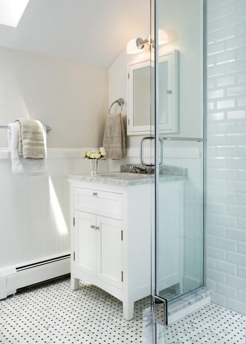 bathroom / bathrooms - skylight greige walls subway tiles shower surround frameless glass