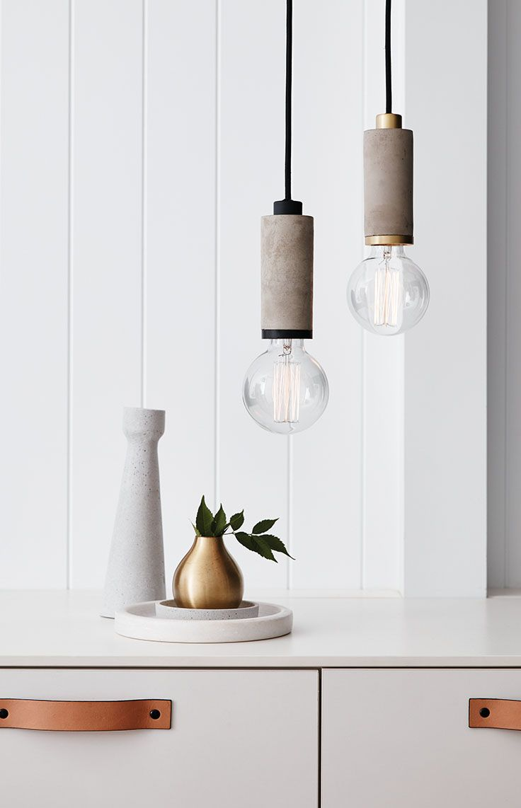 The Beacon Lighting Matteo 1 light pendant in concrete with black detail.