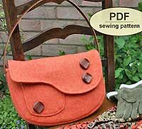 The Boxford Clutch pattern by Charlies Aunt - beautiful vintage inspired handbag in a yummy fabric!