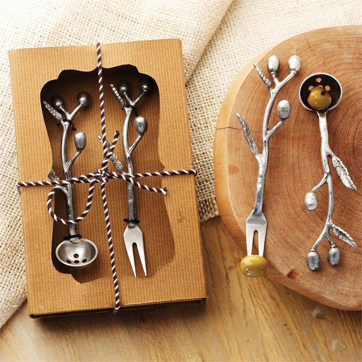 Olive fork and spoon set has metal olive branch handles and comes packaged in rolled corrugated gift box.