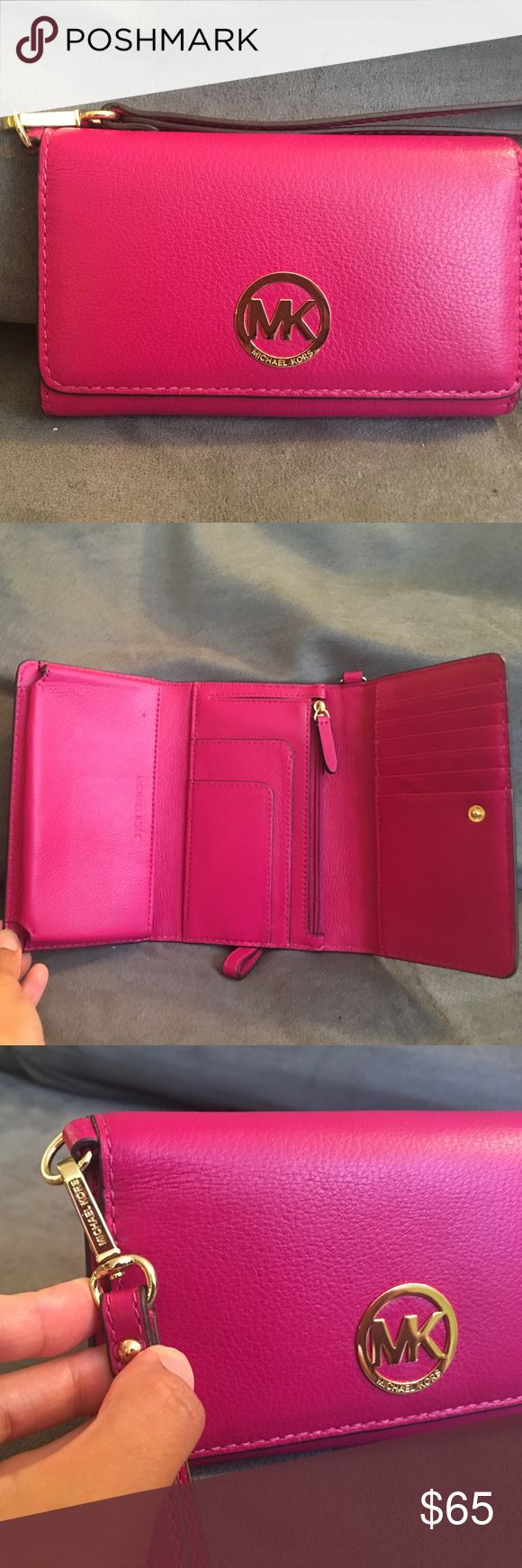 NWOT! Michael Kors pink phone/wallet wristlet! NWOT!! When open, has a slot for your phone, zipper for coins, six credit card slots, pocket behind zipper for cash, and two slots in front of zipper. Michael Kors Bags Wallets