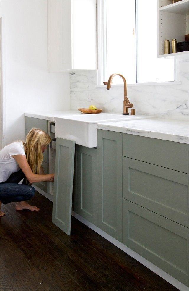Smitten Studio's Ikea hack kitchen remodel | Remodelista. The genius part is purchasing IKEA cabinets without the doors and drawer faces and having new ones made. Bottom cabinets painted in FarrowBall Pigeon. Tops are FarrowBall Wimborne White. High end looking kitchen at an affordable price.