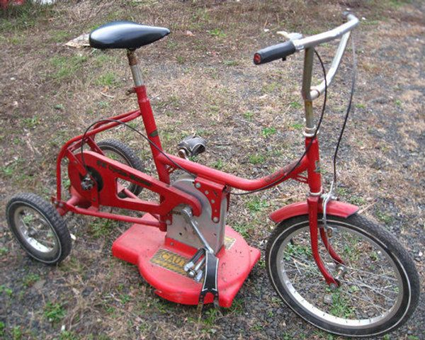 A tricycle lawnmower. What a great punishment for naughty kids lol This made me laugh so hard :) How funny!