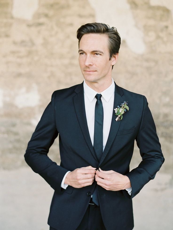 great groom style | slim black suit and narrow neck tie | Whimsical + Botanical Franciscan Gardens Wedding Inspiration