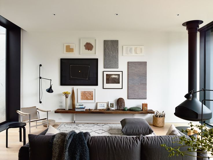 living room. suspended fireplace, Lampe Gras, gallery wall