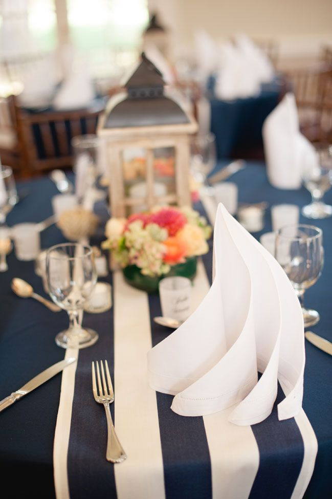 Sail Fold Napkins | Coral & Navy Vintage Inspired Nautical Wedding At The Ribault Club Jacksonville Florida | Photograph by Britney Kay Photography   http://storyboardwedding.com/vintage-nautical-wedding-ribault-club-jacksonville-florida