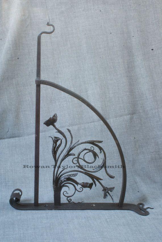 Hanging basket bracket, blacksmith forged.