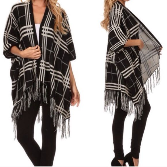 Black and white plaid fringe kimono cardigan Size large, but oversized style can fit a small or medium. Sweaters Cardigans
