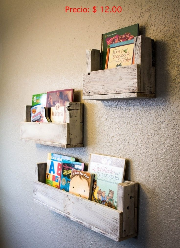 book holders for the wall right when you walk into the room. the awkward wall. might as well use the space for something productive.