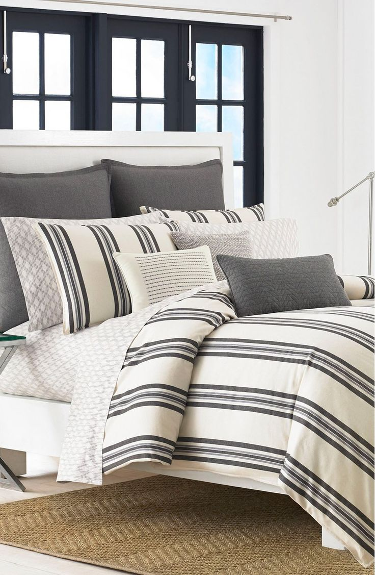 Classic charcoal-and-beige stripes stand out against a neutral palette on a cotton comforter and coordinating pillow shams for a bedroom set that transcends trends.
