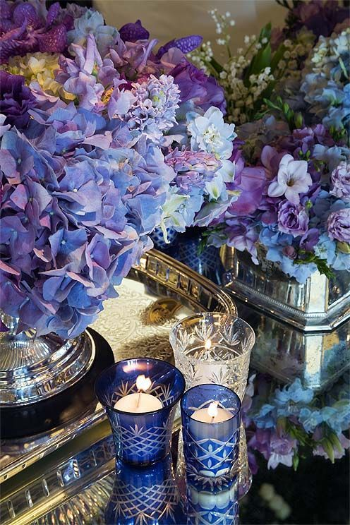 BREAKING NEWS BULLETIN: Pantone Color Of The Year 2016 - laurel home | via Colin Cowey Weddings | Beautiful Hydrangeas with blues and purples and old silver, candles and mirror. Doesn't get any better than that. Pantone? Are you listening? Probably not.