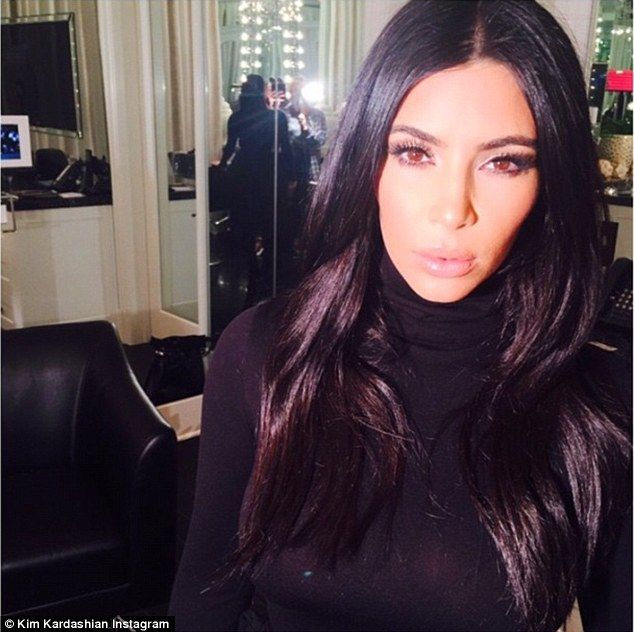 Beauty insider: Kim Kardashian is set to reveal the secrets to her make-up look in a video tutorial set to be released this summer - she posted this selfie on Saturday
