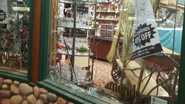 A broken window at Murdoch's Gem Shop on Main St. Friday morning. One man has been arrested after the break in!