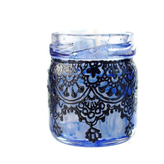 Gift Set of Three Moroccan Inspired Mini Jar Candles- Blue Glass with Black Lace Detailing  This set of three unique candles takes the jar to a whole new level! Perfect for adding hand crafted elegance to any event, from a lavish wedding to an evening dinner on your own patio. These mini candles come in hand embellished jars that can be re-used once the candle is done- the detailing is baked on to permanently set, so jars can be wiped down with a wet cloth without worry of damage. If you…