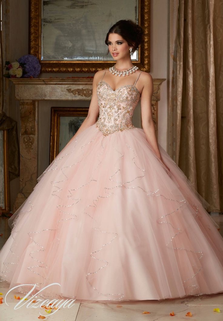 Morilee Vizcaya Quinceanera Dress 89101 JEWELED BEADING ON A FLOUNCED TULLE BALL GOWN Matching Bolero Jacket. Available in Aqua/Gold, Blush/Gold, Coral/Gold, White (Color of this dress): Blush/Gold