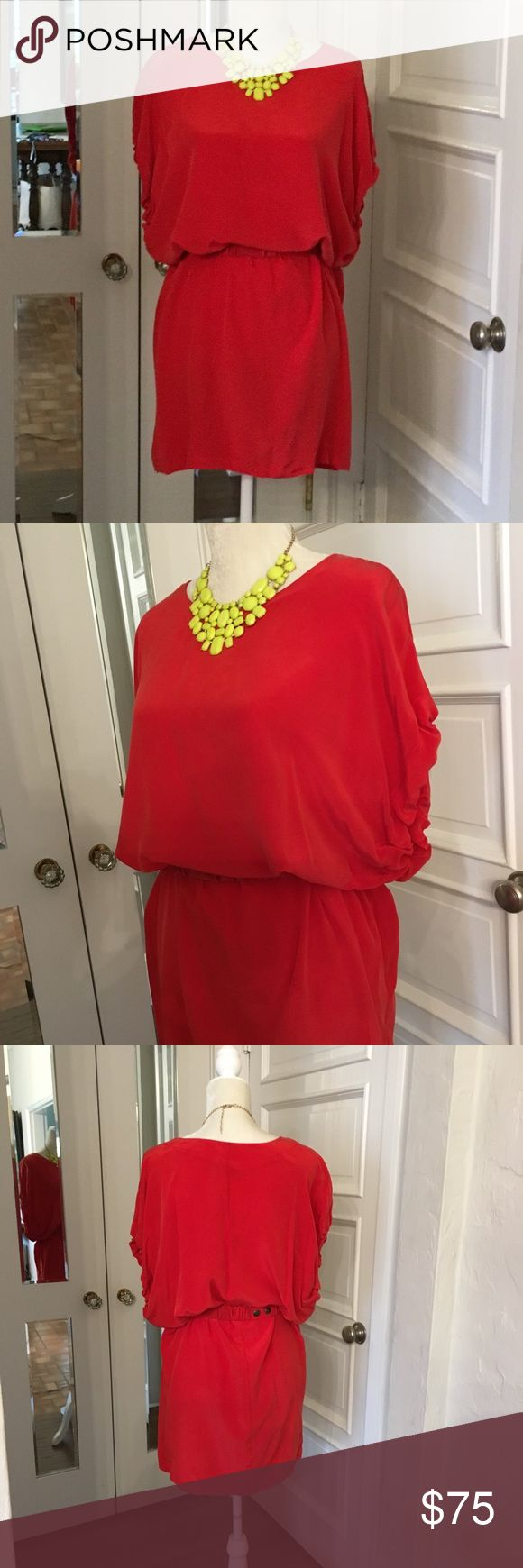 Toupy Paris Red Silk Dress Gorgeous NWOT red silk dress from Saks Off5th. Hand washable. Never worn. Can be worn with matching belt to cinch waist or without. Dolman short sleeves. Nonsmoking household; excellent condition. Toupy Paris Dresses Mini