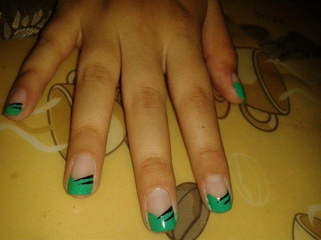 Glam Nails Uñas siempre lindas Diseño de uñas Verde menta con detalles  negros