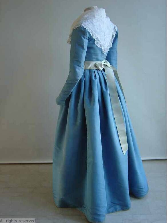 Rear view, levite or round gown, The Netherlands, 1780-1800. Sky blue silk taffeta with a light blue silk sash.