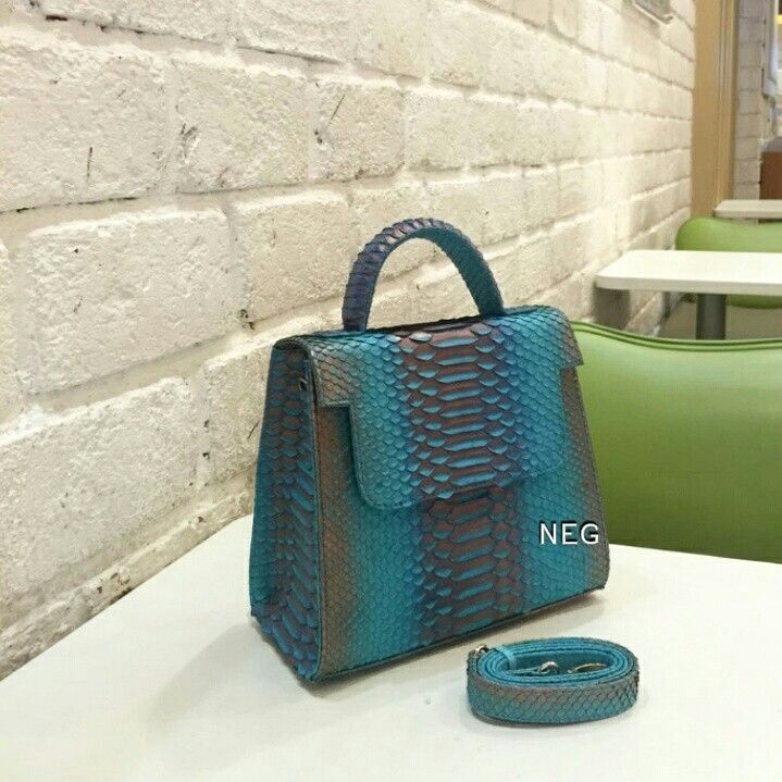 Feel the different with gorgoeus color CHIKA Bag, real python Skin .. peacock color