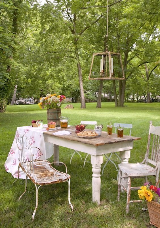 Carol Spinski's outdoor farm table, featured in the book 'Romantic Prairie Style'.