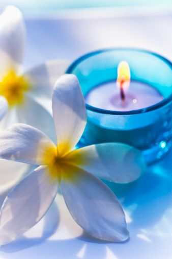 Plumeria and candle