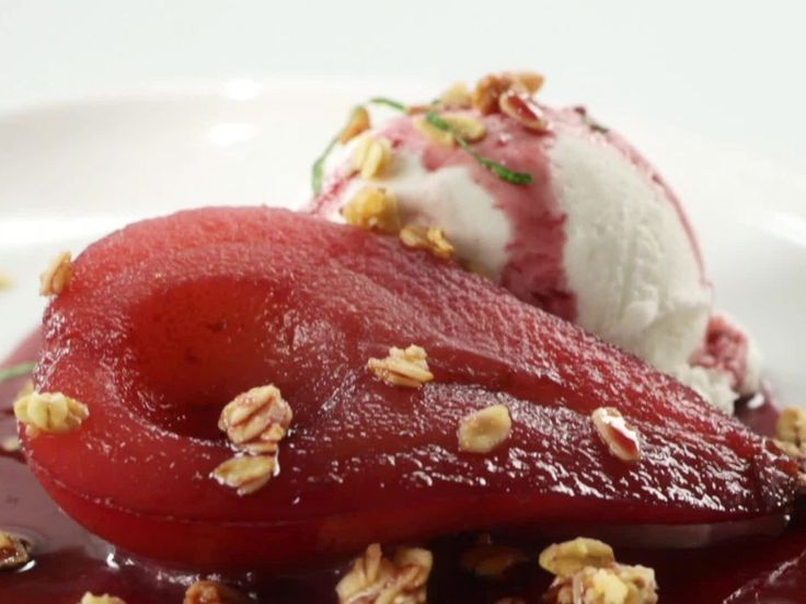 Red Wine Poached Pear Filled with Vanilla Ice Cream and Topped with Granola recipe from Jeff Mauro via Food Network