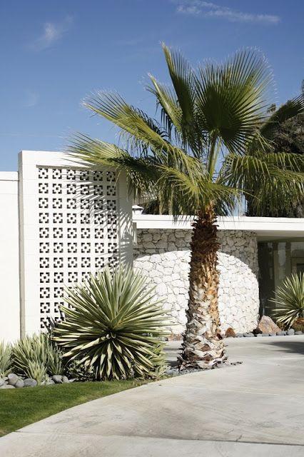 mid-century modern white breeze block and desert landscaping