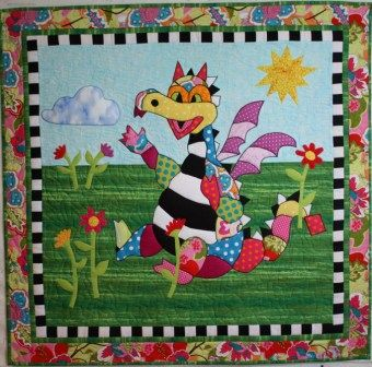 "Quilt Pattern:  Snapdragon 	 		Snapdragon is an adorable dragon quilt pattern designed by Barbara Jones of bj designs and patterns.  Perfect for a baby's room.  The pattern includes full size templates and detailed instructions.  Skill level is intermediate.  The finished quilt is 35"" by 36""."