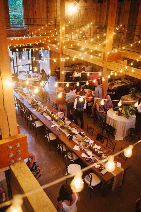 fall rustic barn wedding reception with string lights