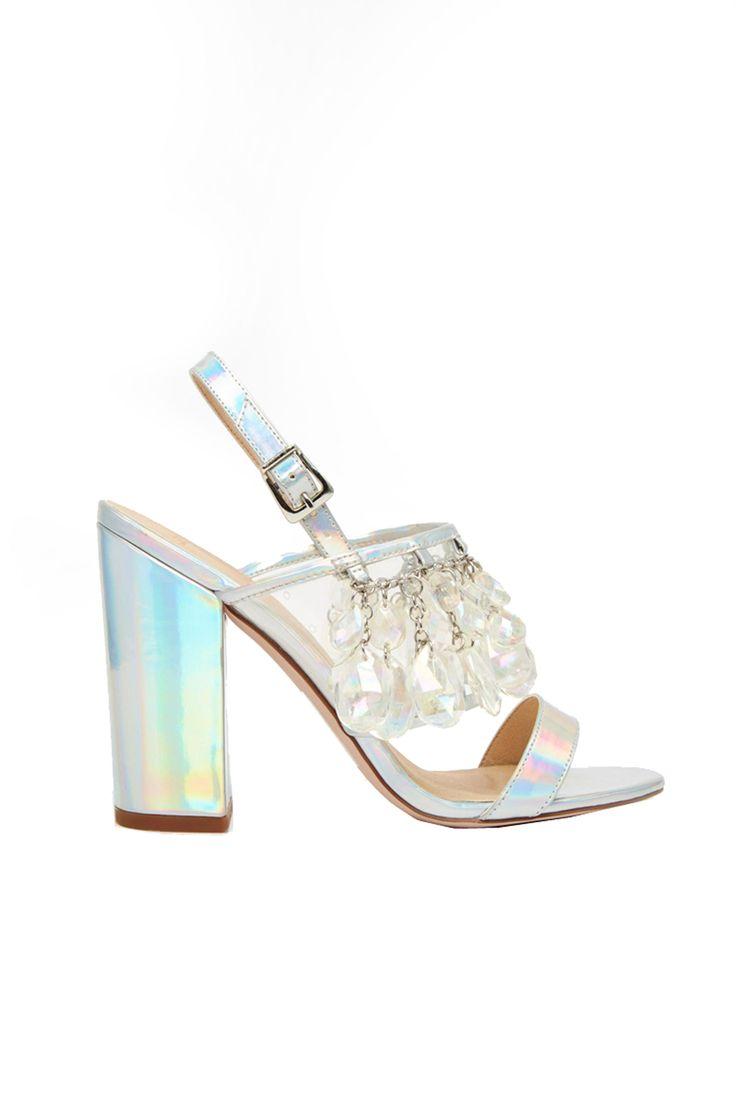 """Iiiiiii'm gonna swiinnngggg from the chandeliieerrrrr, from the chandeliiiierrrrr."" ASOS holographic heeled sandals, $118; asos.com.   - MarieClaire.com"