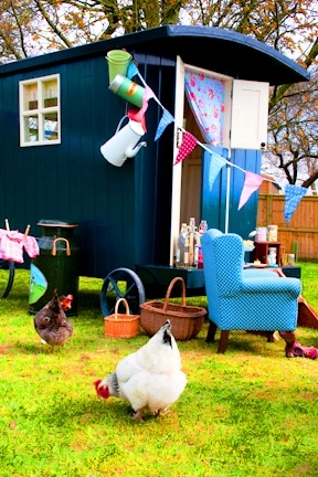 I can see myself here.  (Minus the chair, that's just silly . . . unless I put diapers on the chickies.)  ♥