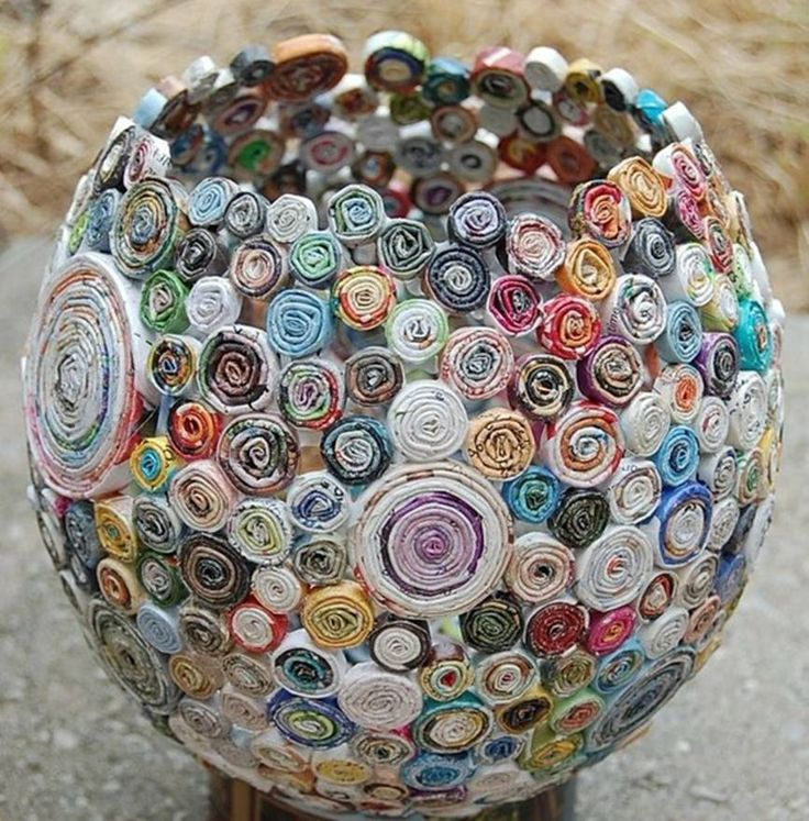 blow up balloon, take old newspapers and roll them like swirly things, paste to balloon. let dry, pop balloon. ... basically how you would do paper mache