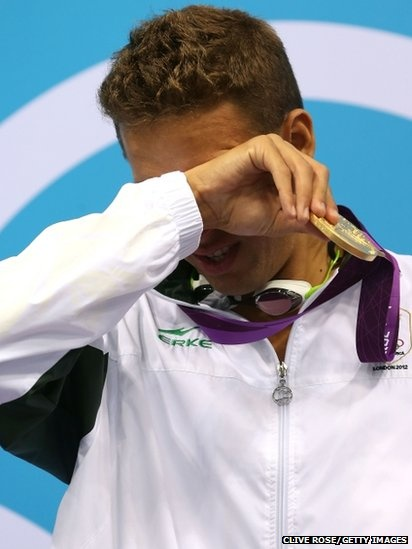 Chad le Clos, of South Africa, was overwhelmed with emotion when he mounted the podium to collect gold for his victory over Michael Phelps in the 200m butterfly final.