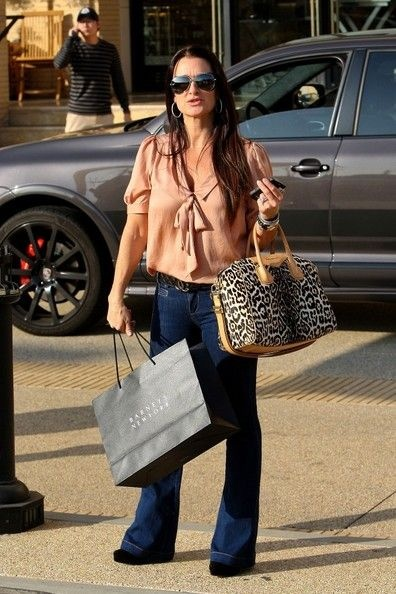 Kyle Richards - lover her style, LOVE her outfit-- bow tie blouse, dark boot cut jeans, high heels.
