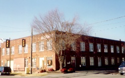 The Kouris Warehouse was built in the early 1930s as a wholesale fruit and vegetable market with a refrigerated basement. It reflects a time when Shelby's economy was based on the agricultural production of Cleveland County's farmers.