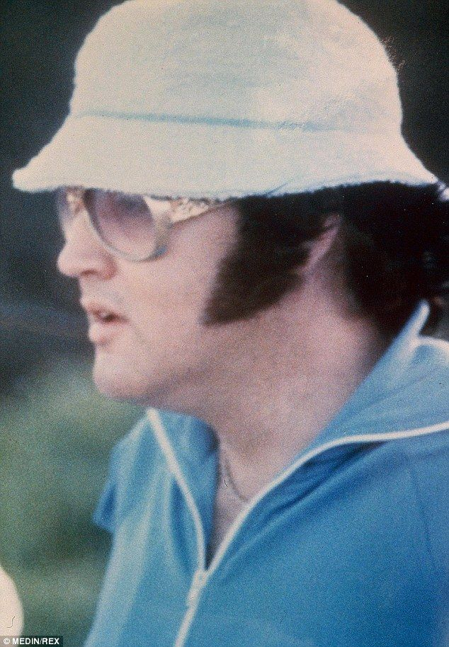 Chill: Ginger said Elvis had a relaxing time on their Hawaiian vacation but it was cut short when he got sand in his eye and scratched his cornea. He wanted a doctor in Memphis to check it out