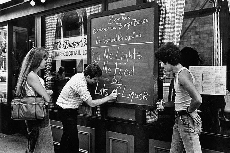New York Blackout  A restaurant owner writes a sign to advise customers that there is no food and no lights, but lots of liquor after the New York blackout July 13, 1977 in New York City.  Bars were doing this when the city blacked out during Hurricane Sandy. It was pretty wild walking through Manhattan and seeing bars lit solely by candlelight.