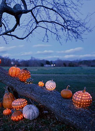 Awesome decorating idea to use throughout the holidays.  Carve/poke holes in pumpkins or gourdes... Super cute for walkway or path to front door welcoming guests to your home for a holiday get-to-gether!