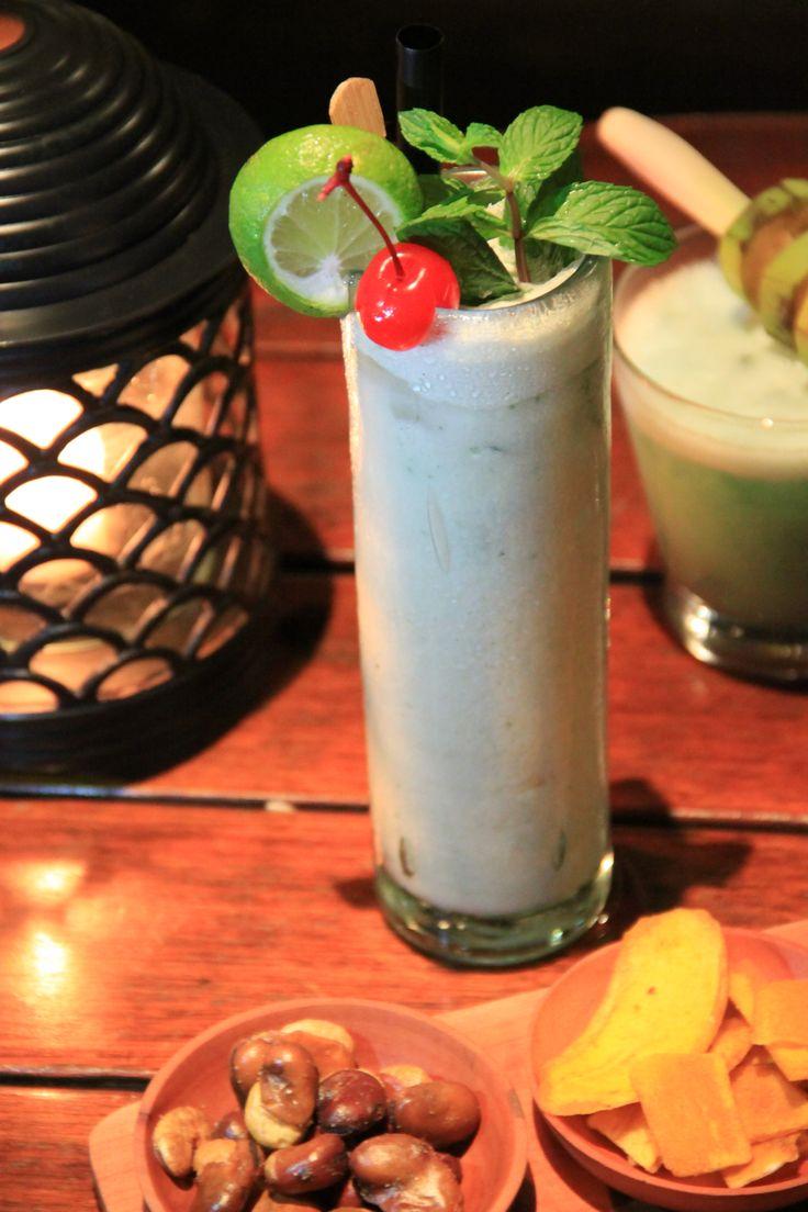 Relax at Belmond Jimbaran with a Salju Bali cocktail - a delicious mix of Arak, coconut cream, lemon, honey and mint.